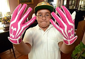 12-year-old Julian Connerton wearing pink gloves in honor of his mother