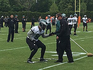 Eagles' rookie Derek Barnett receives some hands-on coaching at rookie camp on Friday. (Photo: John McMullen/973espn.com)