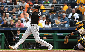 The Phillies are reportedly interested in lefty bat Yelich (Justin Berl/Getty Images)